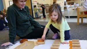 Michaela Jones (5) works pretzels during math time